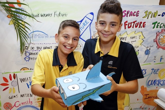 From left, Gems National Academy pupils Jad and Ryan, both 11, at the What Works Future initiative on Monday, part of Dubai's Knowledge and Human Development Authority's overall plan to provide a more complete education. Chris Whiteoak for The National