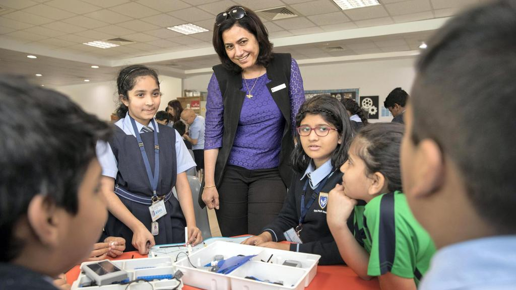 Gems Modern Academy's principal Nargish Khambatta pictured with year four pupils in the Budhayana Spark Lab. Modern Academy is the only Indian curriculum school to have earned an 'outstanding' rating in the latest round of private school inspections in Dubai. Antonie Robertson / The National
