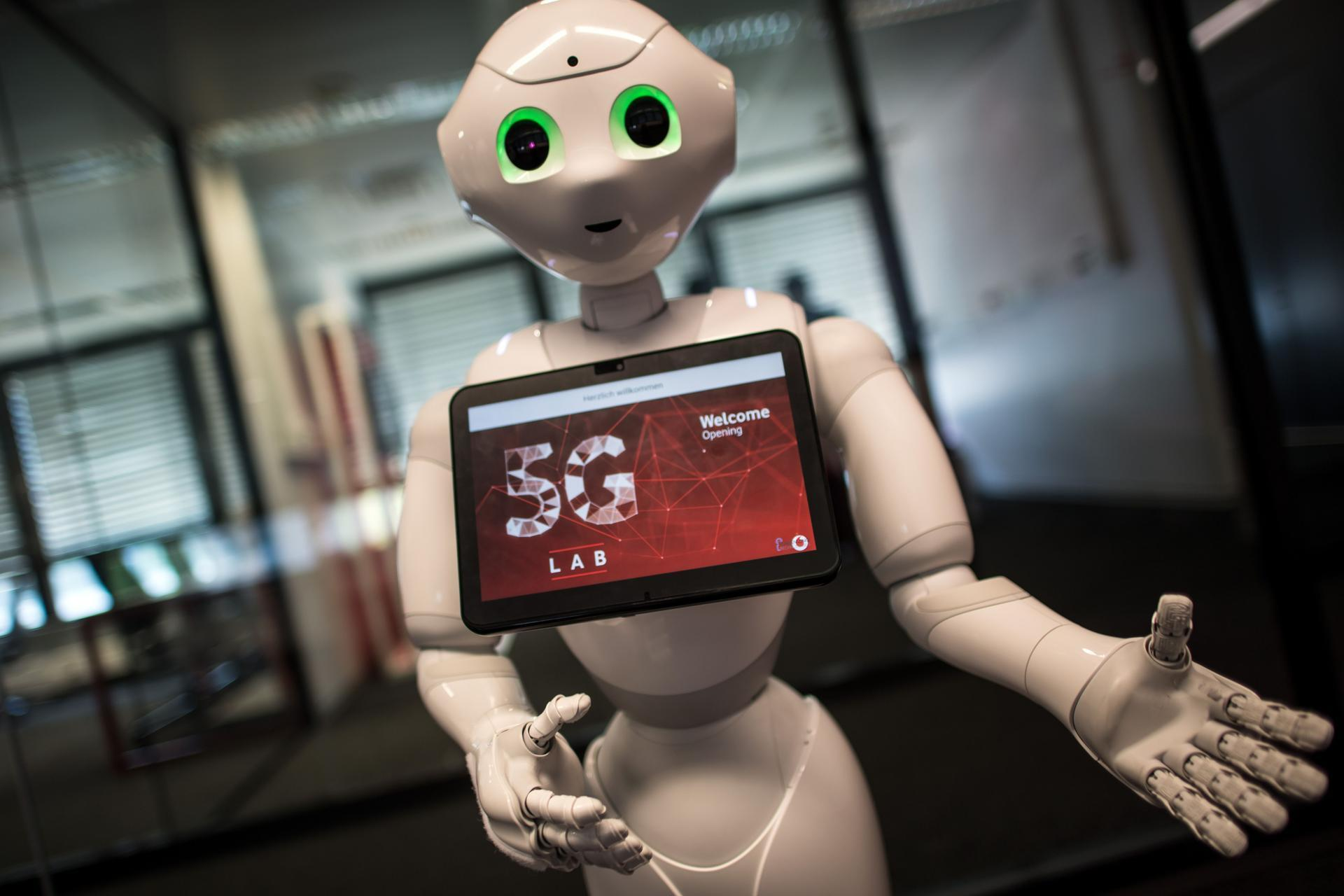 "Robot ""Pepper"" welcomes guests arriving at the Vodafone 5G Lab in Duesseldorf, Germany. AFP"